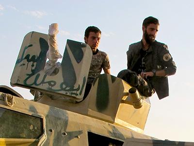Combatientes de la milicia asiria MFS cerca de Raqqa (2017) | © Karlos Zurutuza