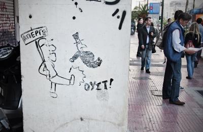Pintada contra los banqueros en una pared de Atenas | © Andrés Mourenza