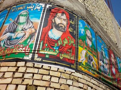 Mural chií con imágenes de Ali en Bagdad | ©  K. Zurutuza